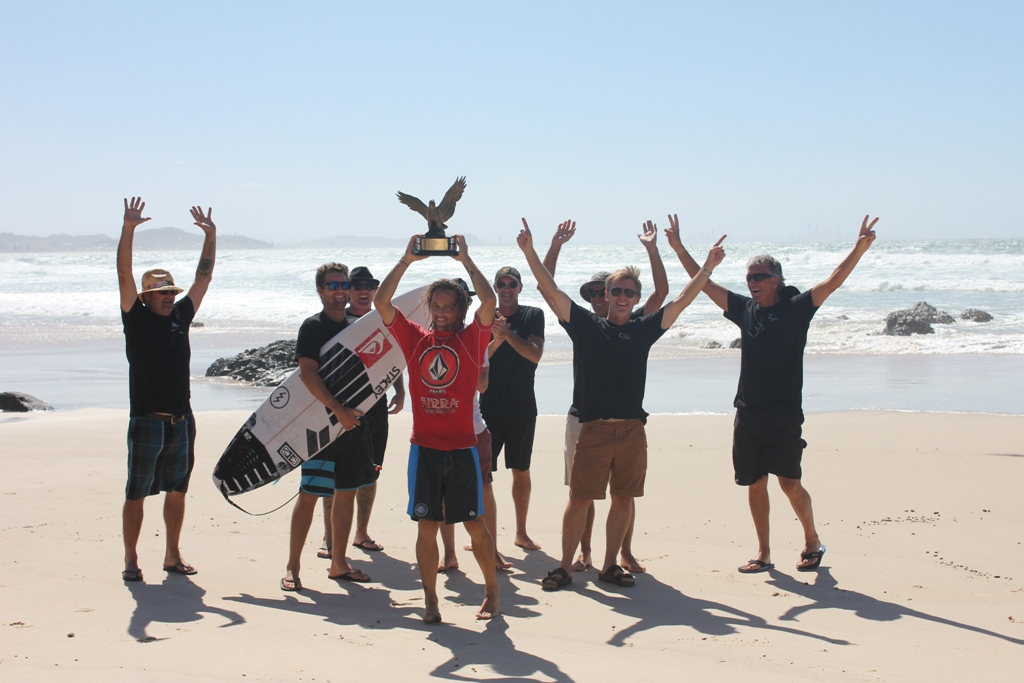 Merewether team, with Jesse Adams in red, celebrating their 2014 Kirra Teams Challenge Win